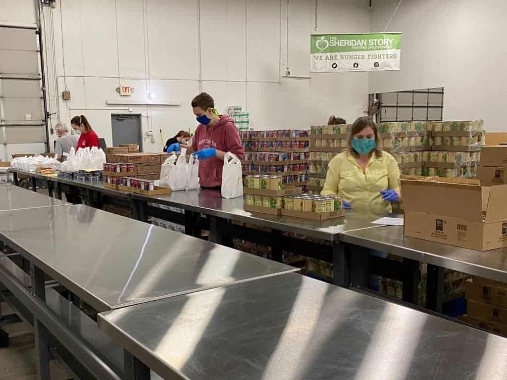 Volunteers packing food during COVID-19 pandemic