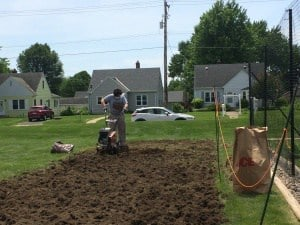 New Life Presbyterian Church garden partnership - tilling the garden